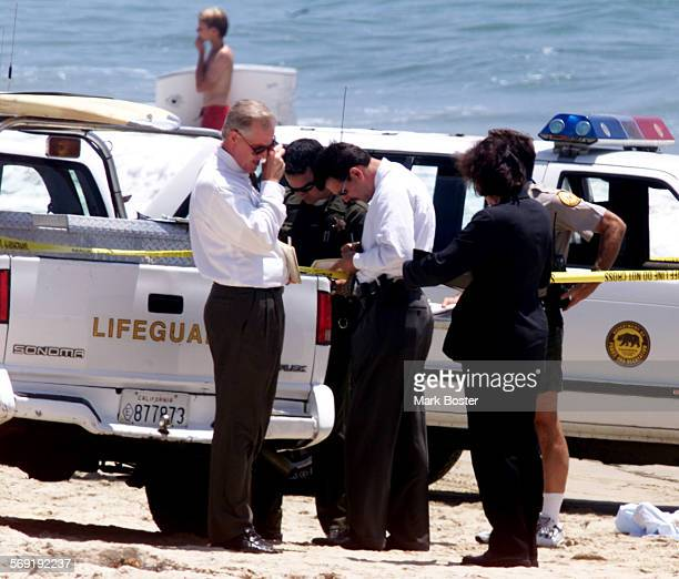 ME0712drown3MB–– Detectives State Park Rangers and Lifeguards conduct an investigation on the beach in an area of the Crystal Cove State Park known...