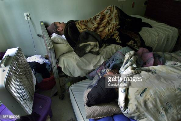 0203931128squat7cc Sandra Kimbel age 38 and her daughter Virginia Kimbel age 10 sleep in what were hospital beds in their rented room at the former...