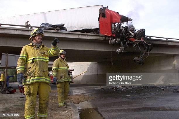 ME1204accident2RG –– Firefighters work to clean up debris following a five–car pileup on the Westbound I–10 in San Bernardino County just West of...