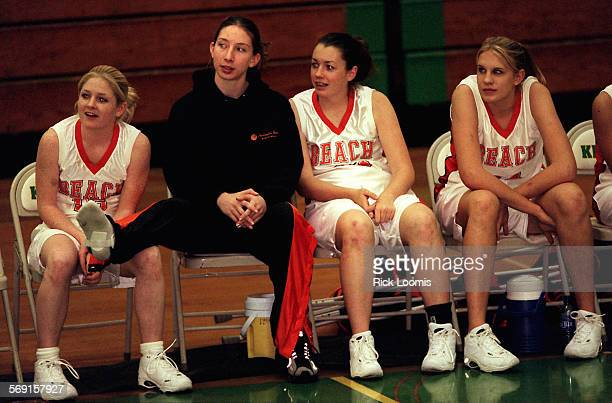 SP1206basketbal2RL––La Palma––Kelsey Ball second from left a junior at Huntington Beach High School sits with her teammates nursing a bad ankle...
