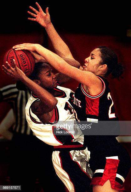 SP1212basketbal2RL––Fullerton––San Clemente's Ashley Housley right forces a turnover by putting pressure on Troy's Gabrielle Spence left during their...