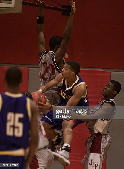 Fremont07KM–– Crenshaw's 5 Marcus Williams is trapped by Willie Dunn and Eric Webb Fremont defeated Crenshaw 78–77