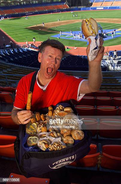 FO0619baseball2AR Dodger Stadium is the backdrop for baseball inspired food Dodger peanut vendor Roger Owens holds a bag full of Homemade Hot Dog...