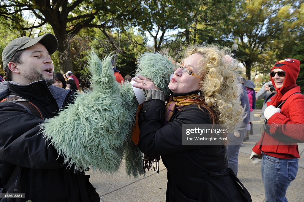 Michael Schupback, a former puppet builder for Sesame Street gives a puppet kiss to Erika Vick shortly before the Million Puppet March on Capitol Hill in Northwest Washington. November, 03, 2012 in Washington, DC.