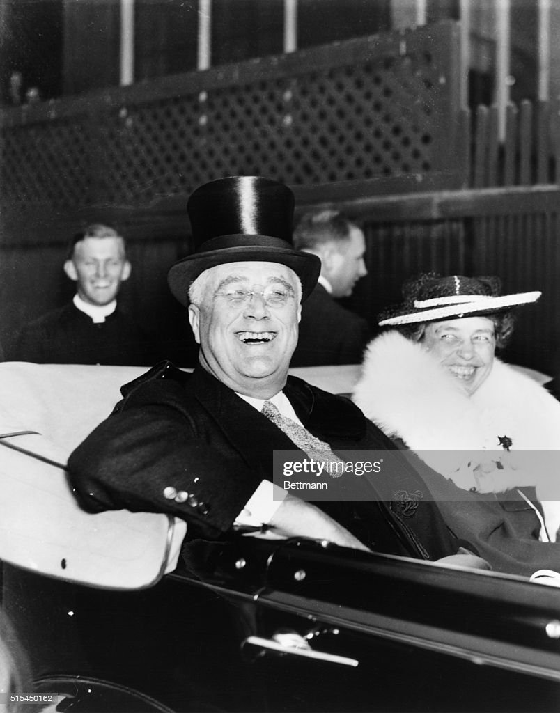 Washinton, D.C.- Leaving church after Easter Day services, flashing one of his radiant smiles President Franklin D. Roosevelt radiates the happy spirit of the holiday as he leaves the St. Thomas Episcopal Church in a car with Mrs. Roosevelt and Major Hooker, a close friend of the family's Hyde Park, N.Y..
