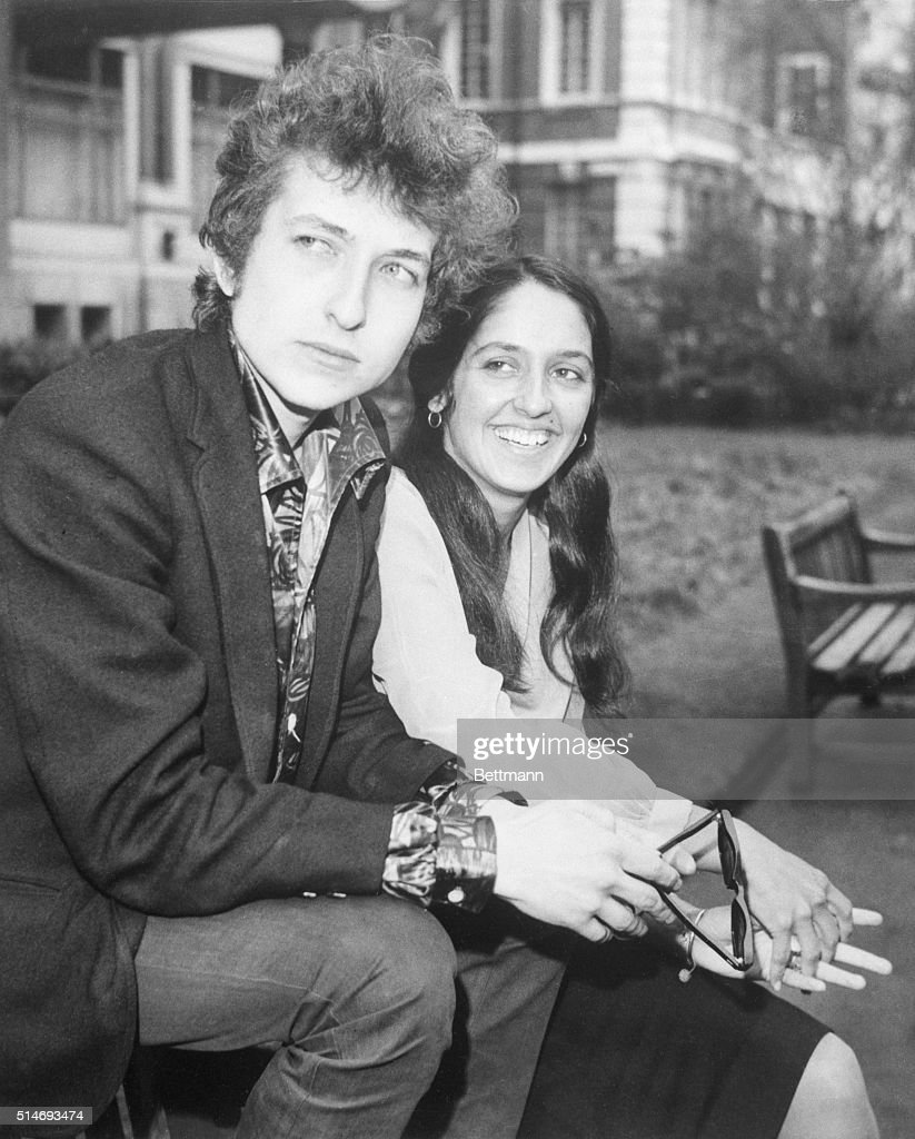 American folk singers Bob Dylan and Joan Baez shown seated together.