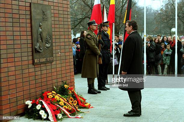 *German politician Chancellor 19982005attending the inauguration of the monument for former German chancellor Willy Brandt in Warsaw The monument...