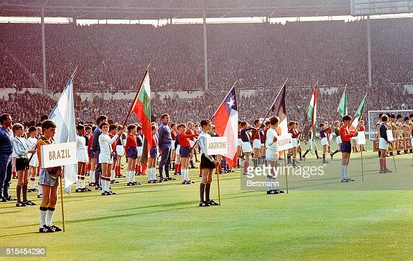 London England At opening ceremony of the World Cup Soccer championships at Wembley Stadium London schoolboys bear the banners and wear the colors of...