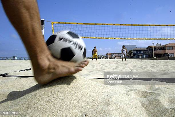 ME0702footvoll The ball is served with the foot The player puts it on a mound of sand and kicks it over the net Footvolley is a sport that is a cross...