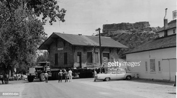 JUL 7 1970 JUL 8 1970 '0l' Snort' a 37ton truck generating 475 horsepower moves the Denver Rio Grande Western Railroad depot at Castle Rock Colo...