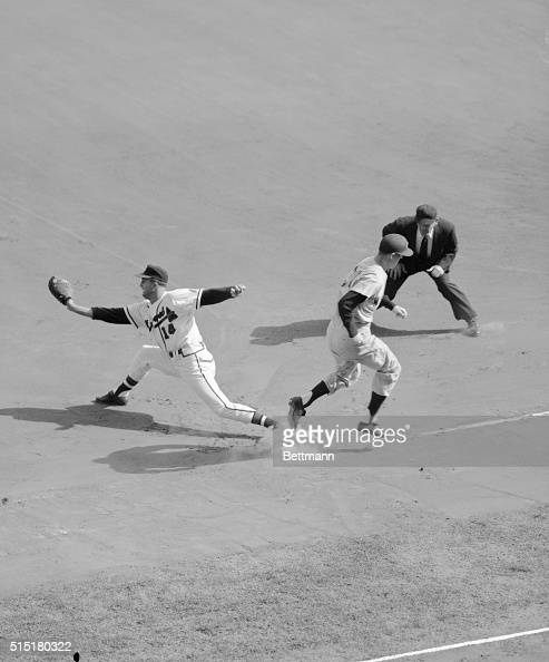 MilwaukeeWI Tony Kubek of NY Yankees crosses first base beating throw to Braves' first baseman Frank Torre by pitcher Warren Spahn in first inning of...