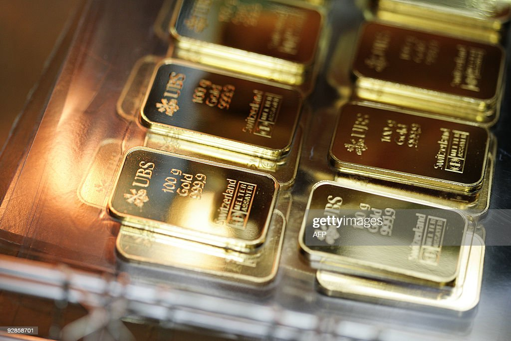 100g golden bars engraved with the logo and name of the swiss bank UBS are pictured on April 6 2009 at a plant of gold refiner and bar manufacturer...