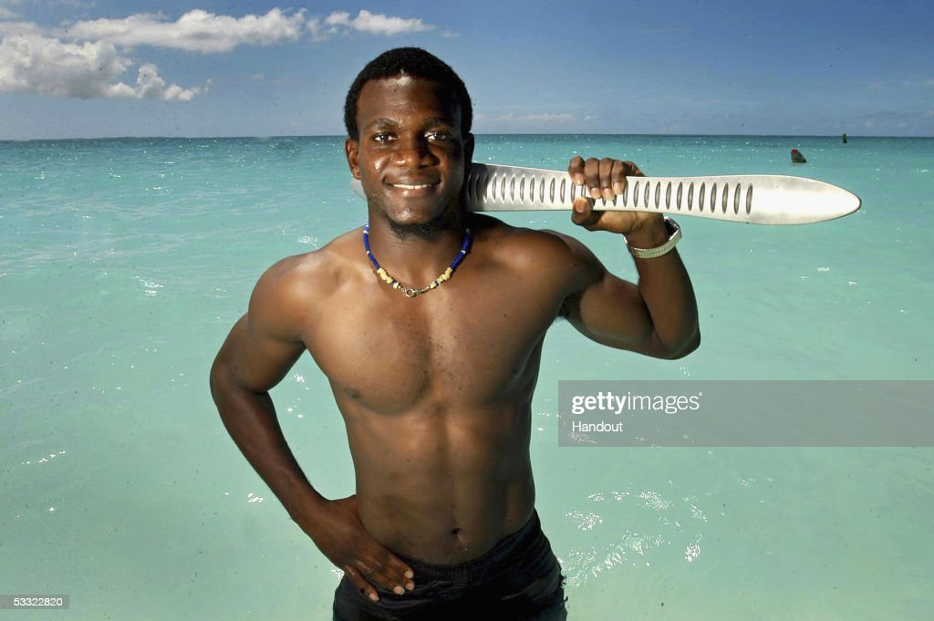 100m and 200m runner Darian Forbes of the Turks and Caicos Islands holds the 2006 Commonwealth Games Queen's baton at Grace Bay beach on August 3, 2005 in the Turks and Caicos Islands. The baton arrives in Australia on January 24, 2006.