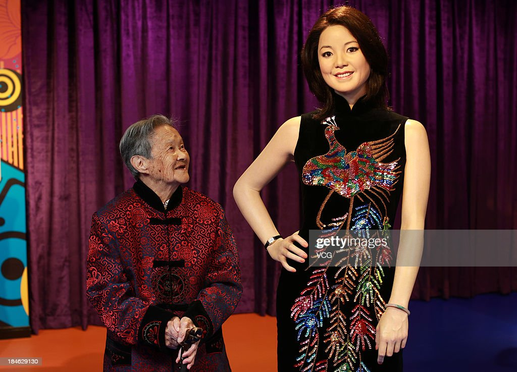 100-year-old Huang Xiaogui poses with a wax figure of Chinese singer Teresa Teng at Madame Tussauds on October 11, 2013 in Wuhan, China. Wuhan Evening News and Huaxia Qianqiu Education Foundation selected ten healthy centenarians in Wuhan city, and invited them to visit the Madame Tussauds to celebrate the Double Ninth Festival.