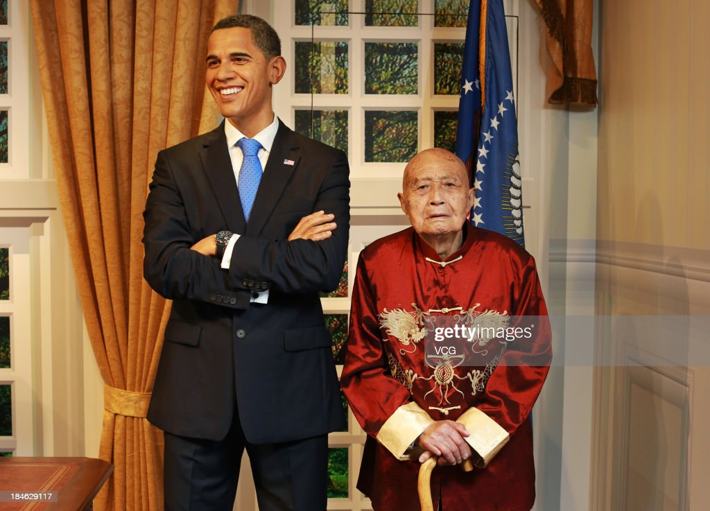100-year-old Liu Jiayuan poses with a wax figure of U.S. President <a gi-track='captionPersonalityLinkClicked' href=/galleries/search?phrase=Barack+Obama&family=editorial&specificpeople=203260 ng-click='$event.stopPropagation()'>Barack Obama</a> at Madame Tussauds on October 11, 2013 in Wuhan, China. Wuhan Evening News and Huaxia Qianqiu Education Foundation selected ten healthy centenarians in Wuhan city, and invited them to visit the Madame Tussauds to celebrate the Double Ninth Festival.
