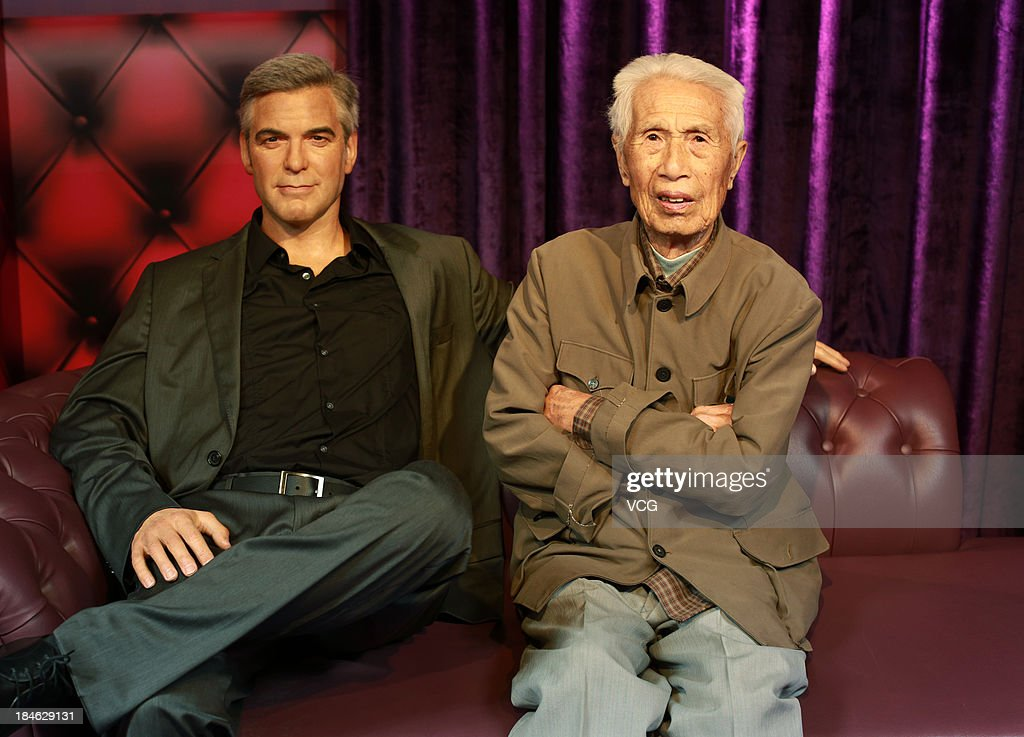 100-year-old Tong Yuqi poses with a wax figure of George Clooney at Madame Tussauds on October 11, 2013 in Wuhan, China. Wuhan Evening News and Huaxia Qianqiu Education Foundation selected ten healthy centenarians in Wuhan city, and invited them to visit the Madame Tussauds to celebrate the Double Ninth Festival.