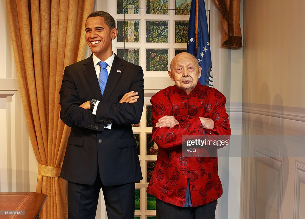 100-year-old Yu Ruihai poses with a wax figure of U.S. President <a gi-track='captionPersonalityLinkClicked' href=/galleries/search?phrase=Barack+Obama&family=editorial&specificpeople=203260 ng-click='$event.stopPropagation()'>Barack Obama</a> at Madame Tussauds on October 11, 2013 in Wuhan, China. Wuhan Evening News and Huaxia Qianqiu Education Foundation selected ten healthy centenarians in Wuhan city, and invited them to visit the Madame Tussauds to celebrate the Double Ninth Festival.