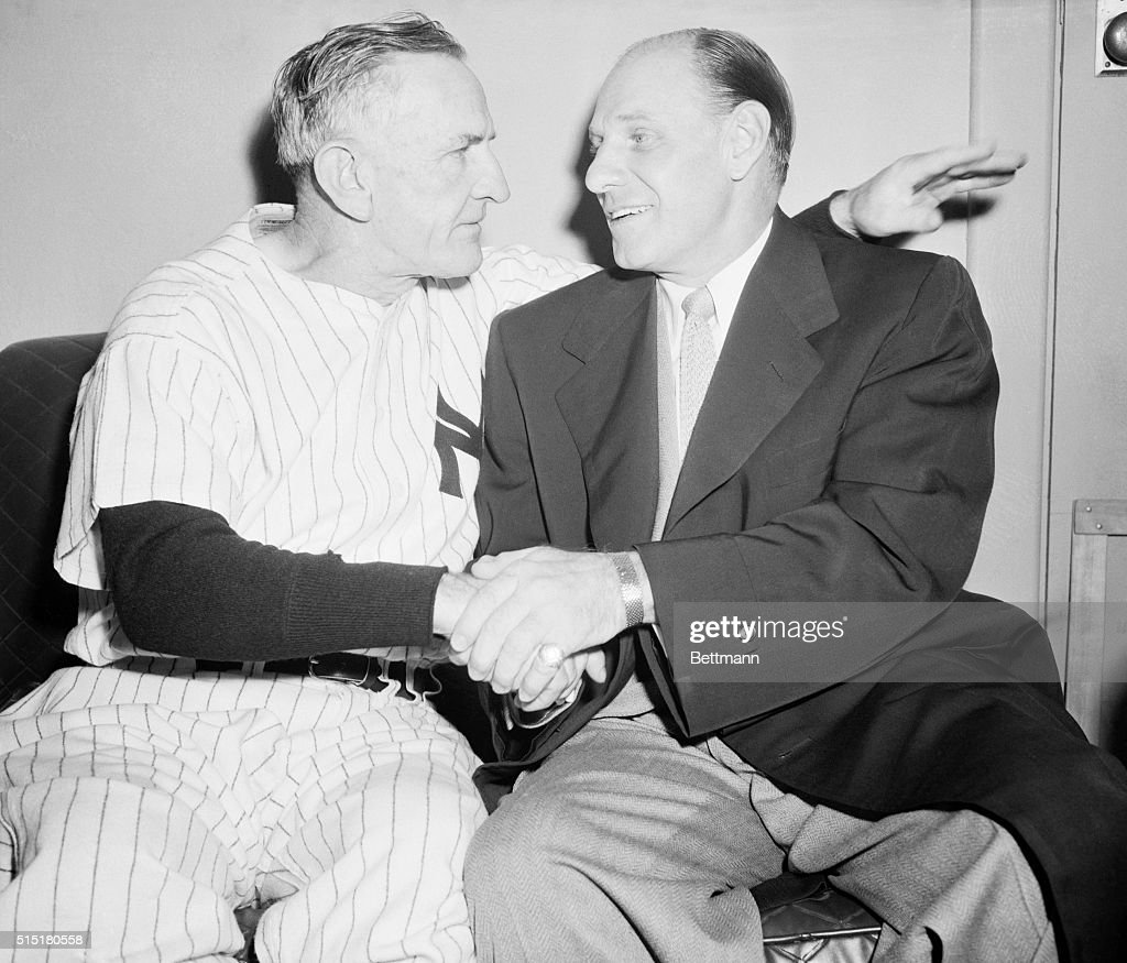 Manager Leo Durocher (R) of the New York Giants, congratulates manager Casey Stengel of the New York Yankees, after the Yankees defeated their opponents 4-3, in the sixth game of the World Series. With this victory, the Yankees took the series four wins to two.