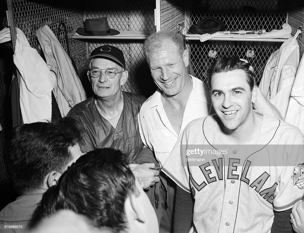 Jubilation reigns in the Cleveland locker room after the Indians topped the Boston Braves 4-3 to win the World Series four games to two. Taking part in the celebration are (L to R) coach Bill McKechnie, Bill Veeck, president of the club, and manager Lou Boudreau.