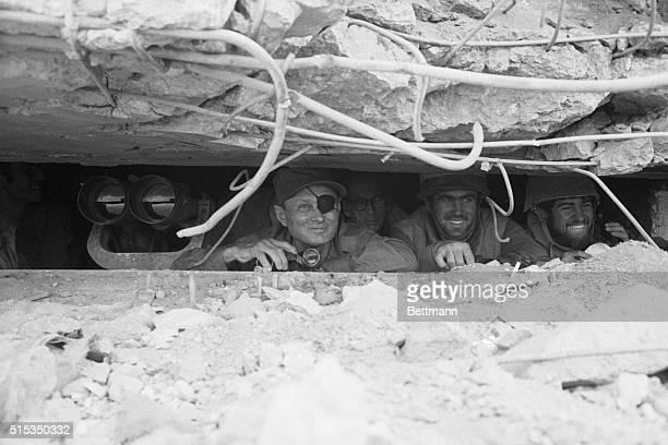 Golan Heights Israel Israeli Defense Minister Moshe Dayan peers through the observation slit on a bunker overlooking a battle scene Dayan described...