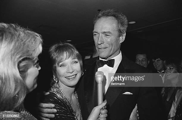 Hollywood California Actor Clint Eastwood walks up behind actress Shirley MacLaine and gives her a hug as she is interviewed shortly before The...