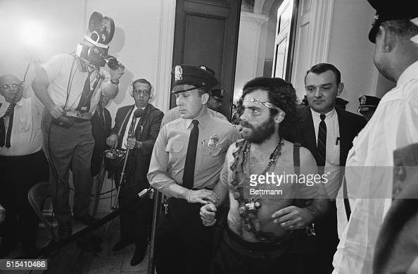 10/1/1968Washington DC Jerry Rubin a leader of the Youth International Party is escorted from a hearing of the House UnAmerican Activities...