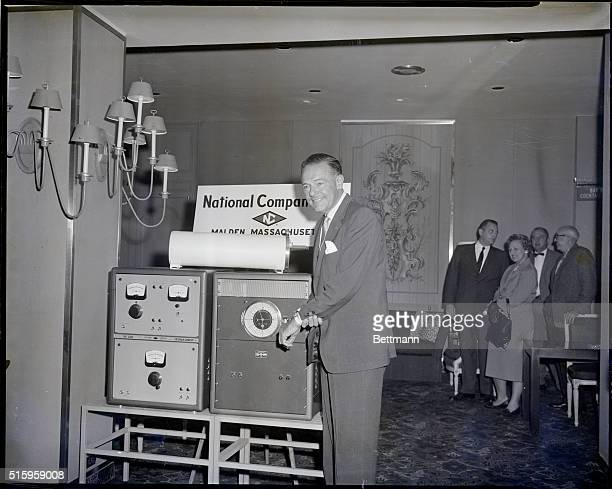 New York NY Republican Presidential Candidate Henry Cabot Lodge checks his watch with the National Company's Atomichron an 'atomic clock' that the...