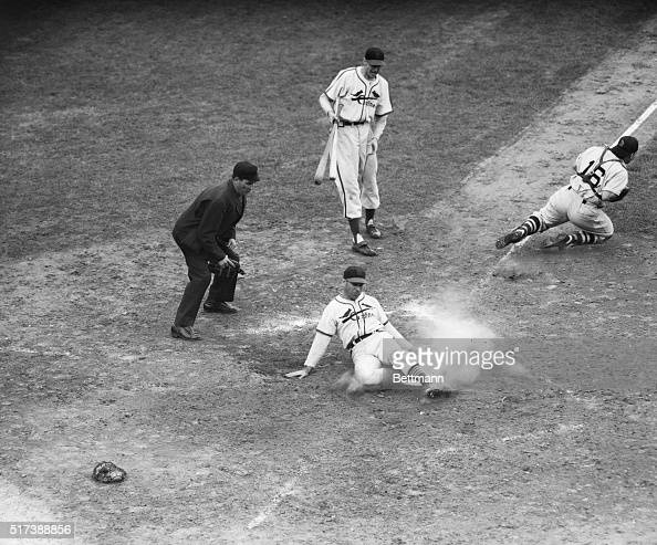 10/15/46St Louis MO Redbird outfielder Enos Slaughter slides across home plate with the winning run of the World Series during the eighth inning of...