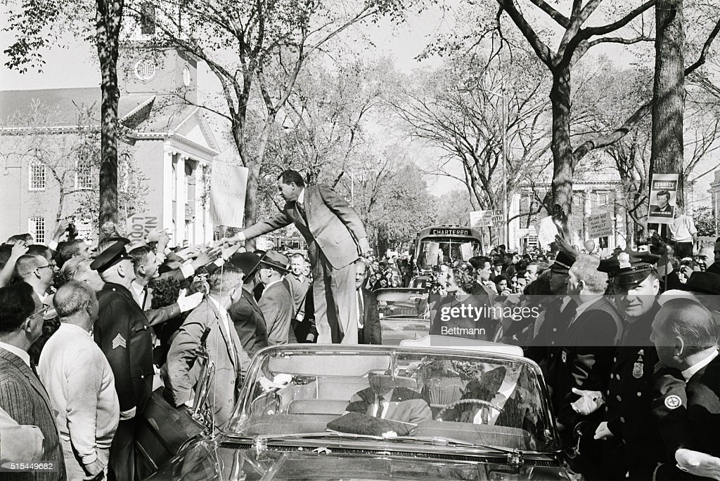 New Haven, CT- Republican presidential candidate, Vice President Richard M. Nixon, greets an enthusiastic crowd from the top of a car. Nixon hit on the defense of the offshore Islands of Quemoy and Mahsu during his motor tour of Connecticut, pressing for a clearer statement of Senator Kennedy's views on this issue in his speech to the voters.