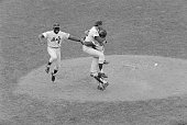 New York NY Met third baseman Ed Charles jumps with joy as pitcher Jerry Koosman and catcher Jerry Grote hug each other after the New York Mets...