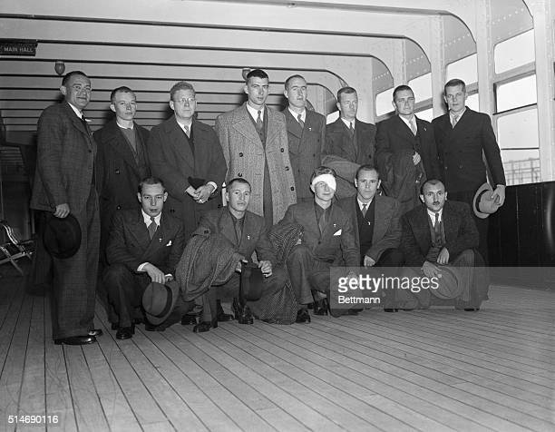 Fourteen American lads who volunteered to fight with the government forces in Spain are shown aboard the SS Queen Mary as they returned to their...