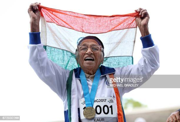 TOPSHOT 101yearold Man Kaur from India celebrates after competing in the 100m sprint in the 100 age category at the World Masters Games at Trusts...
