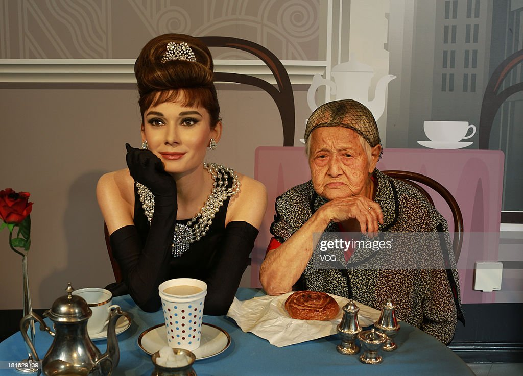 101-year-old Wen Gaishuan poses with a wax figure of Audrey Hepburn at Madame Tussauds on October 11, 2013 in Wuhan, China. Wuhan Evening News and Huaxia Qianqiu Education Foundation selected ten healthy centenarians in Wuhan city, and invited them to visit the Madame Tussauds to celebrate the Double Ninth Festival.