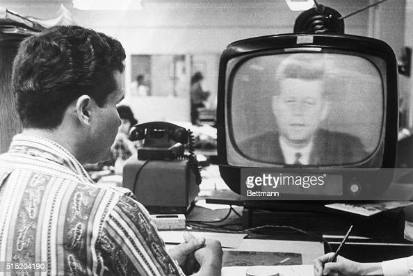Miami FL Federico Fidel Fernandez a Miami Cuban refugee listens to President Kennedy's television address October 22nd in which the President...