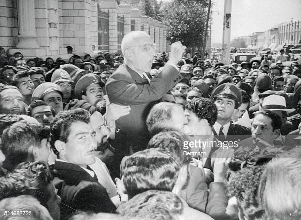 Premier Mohammed Mossadegh of Iran is shown as he addressed a mob of demonstrators outside the Parliament Building last week Mossadegh told the angry...