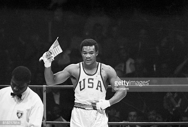 Mexico City Mexico George Foreman of Houston TX waves a small American flag after he won the Olympics heavyweight boxing gold medal to climax...