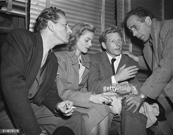 Washington DC MORE STARS DESCEND ON WASHINGTON Filmland celebrities Paul Henried Lauren Bacall Danny Kaye and Humphrey Bogart are pictured at...