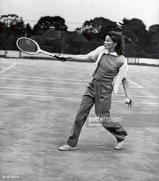 10/3/1940Philadelphia PA Nattily attired in slacks Katharine Hepburn screen and stage star returns a drive during a friendly game of tennis at the...