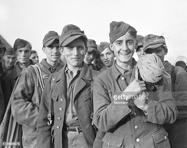 10/3/1945Carentan France A group of typical young German exsoldiers 13 and 14 years old are shown waiting to board a train after near Carentan for...
