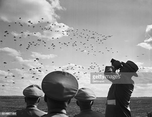 10/5/1949Fort Bragg NC President Truman watches throughhis binoculars as a battalion of paratroopers of the 82nd Airborne divisionfloats to erath...
