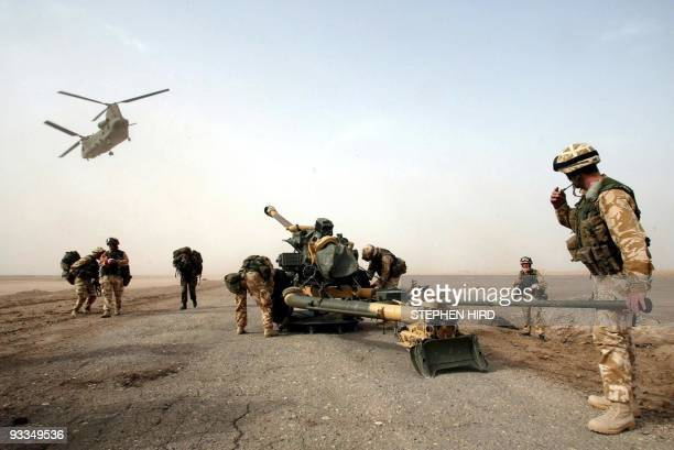 A 105mm gun is dropped by a Chinook helicopter to British 29 Commando Regiment Royal Artillery on the Fao Peninsula in southern Iraq on March 21 2003...