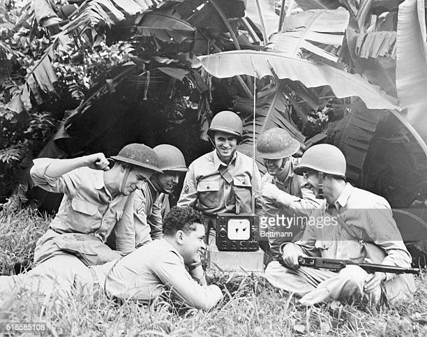 10/7/1942Somewhere in Panama Deep in the jungles of Panama these U S soldiers get excited over the World Series as though they were cheering in the...