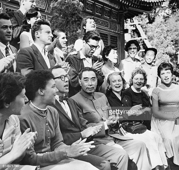 10/7/1957Peiping China Chinese Communist Premier Chou EnLai claps his hands while singing 'Ain't Gonna Study War No More' with members of a youth...