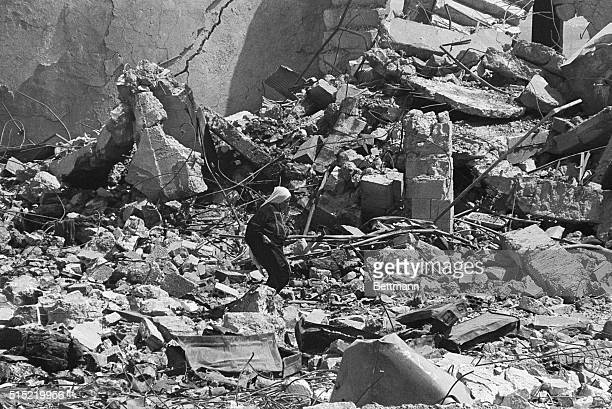 10/7/1970Amman Jordan A woman picks her way through the ruins of a building on the outskirts of Amman recently The building was destroyed during the...