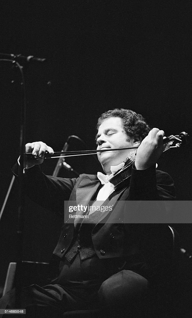 World-Famous violinist <a gi-track='captionPersonalityLinkClicked' href=/galleries/search?phrase=Itzhak+Perlman&family=editorial&specificpeople=593397 ng-click='$event.stopPropagation()'>Itzhak Perlman</a> performs Mendelssohn's Concerto in E minor with the South Carolina Philharmonic Orchestra in Columbia, SC, 10/7. Perlman, who only performs with several orchestras a year, is on a three-day tour that also includes Birmingham, AL, and Chattanooga, TN. He was born in Israel in 1945 and debuted on the Ed Sullivan show in 1958. UPI
