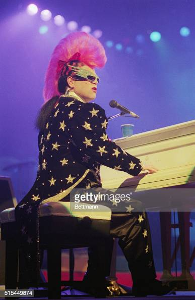 10/7/1986Elton John sporting one of his more unusual hairdos performing at the Universal Amphitheatre