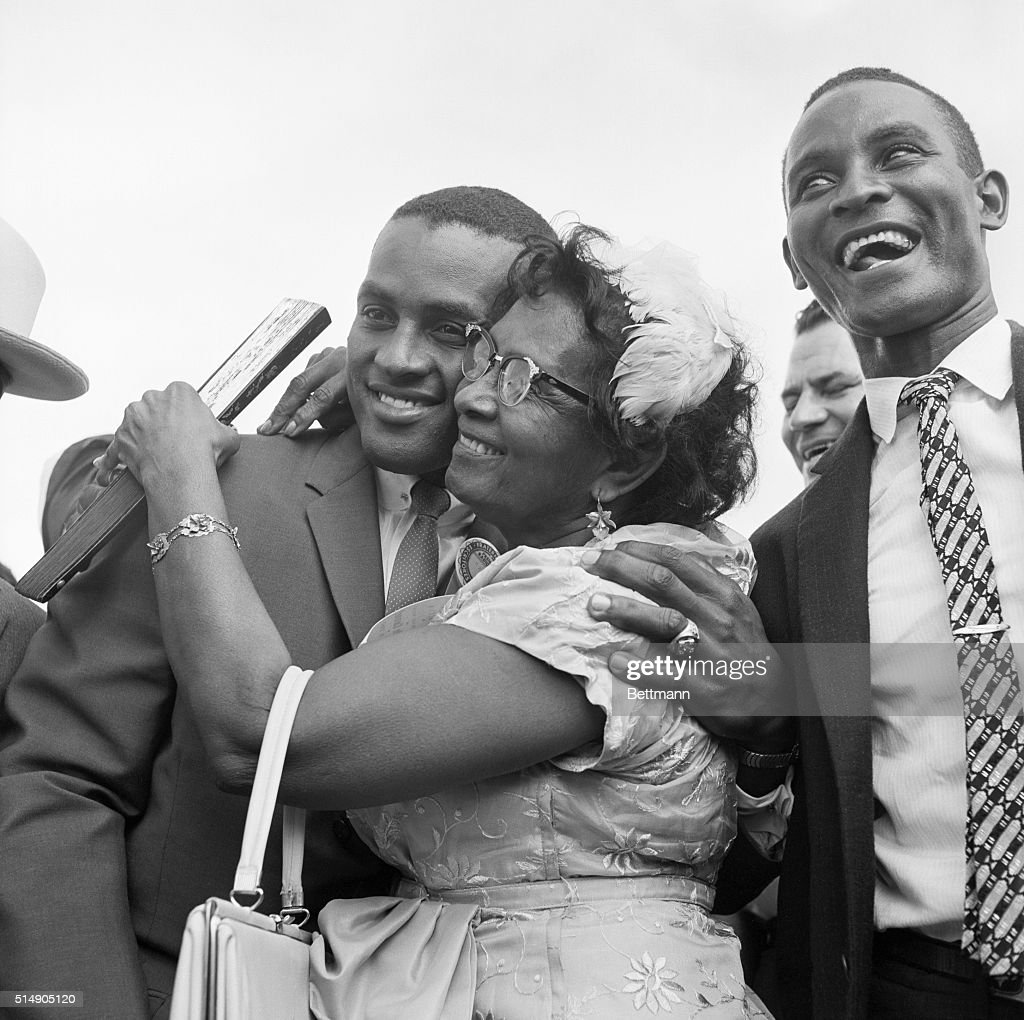 Thousands turned out at the airport to welcome major league baseball stars Orlando Cepeda and Robert Clemente on their return home, but the number one fan turned out to be mother in both cases. Clemente, Pittsburgh's National League batting champ, is shown here receiving a warm parental hug.