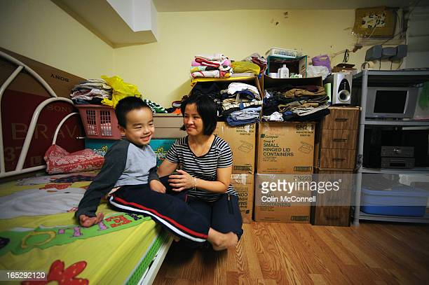 DEC 10th 2009pics of 5 yr old alan tang with his dadtanh quoc tang and his mom binh thuy lualan has cerebral palsy and uses an electic wheelchair and...