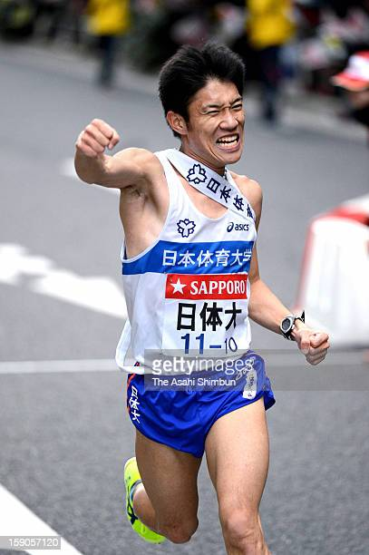 10th and final runner of Nippon Sports Science University Yuichi Taninaga celebrate winning the 89th Hakone Ekiden on January 3 2013 in Tokyo Japan