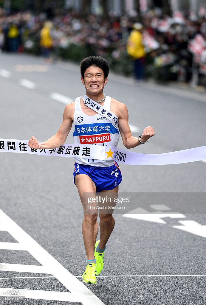 10th and final runner of Nippon Sports Science University Yuichi Taninaga celebrate winning the 89th Hakone Ekiden on January 3, 2013 in Tokyo, Japan.